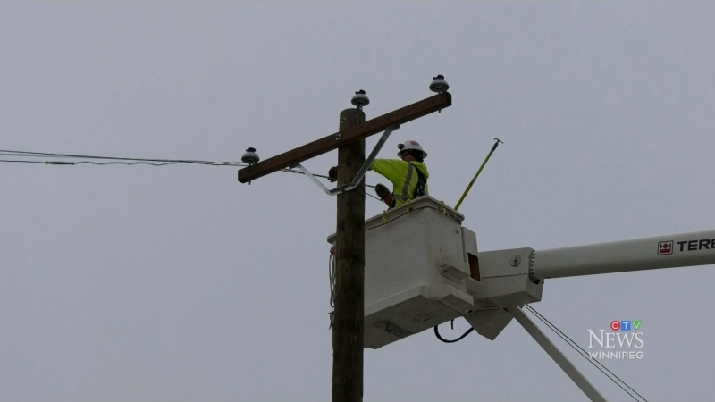 A hydro worker tends to a power line in this undated photo. (Image: CTV News Winnipeg)