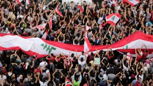 Anti-government protesters shout slogans in Beirut, Lebanon, Sunday, Oct. 20, 2019. (AP Photo/Hassan Ammar)