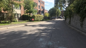 A local resident says the glass on this road was smashed as a result of the shooting in the area of Windermere Avenue and Swansea Mewson on Saturday, Oct. 19, 2019.