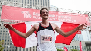 Trevor Hofbauer celebrates after finishing the 2019 Scotiabank Toronto Waterfront Marathon as the top Canadian male, in Toronto, on Sunday, Oct., 20, 2019. THE CANADIAN PRESS/Christopher Katsarov