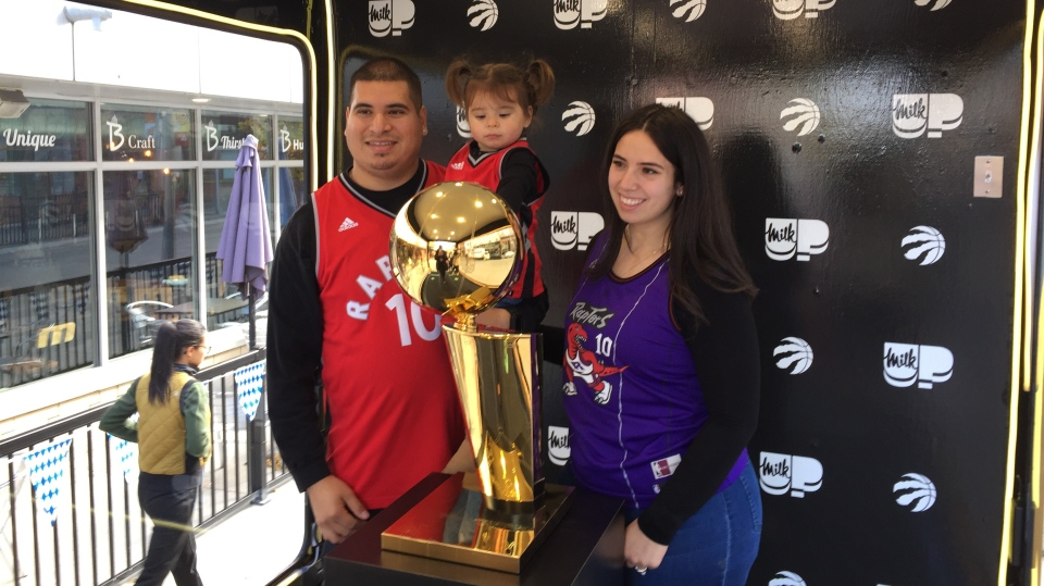A family poses for a photo with the Larry O'Brien Championship Trophy in Kitchener on Sunday, Oct. 20, 2019.