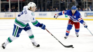 Vancouver Canucks right wing Brock Boeser (6) shoots with New York Rangers right wing Jesper Fast (17) of Sweden defending in the first period of a NHL hockey game, Sunday, Oct. 20, 2019, in New York. Boeser scored on the shot. (AP Photo/Kathy Willens)
