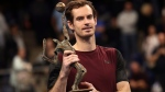 Andy Murray of Britain poses with the trophy after winning the European Open final tennis match in Antwerp, Belgium, Sunday, Oct. 20, 2019. (AP Photo/Francisco Seco)