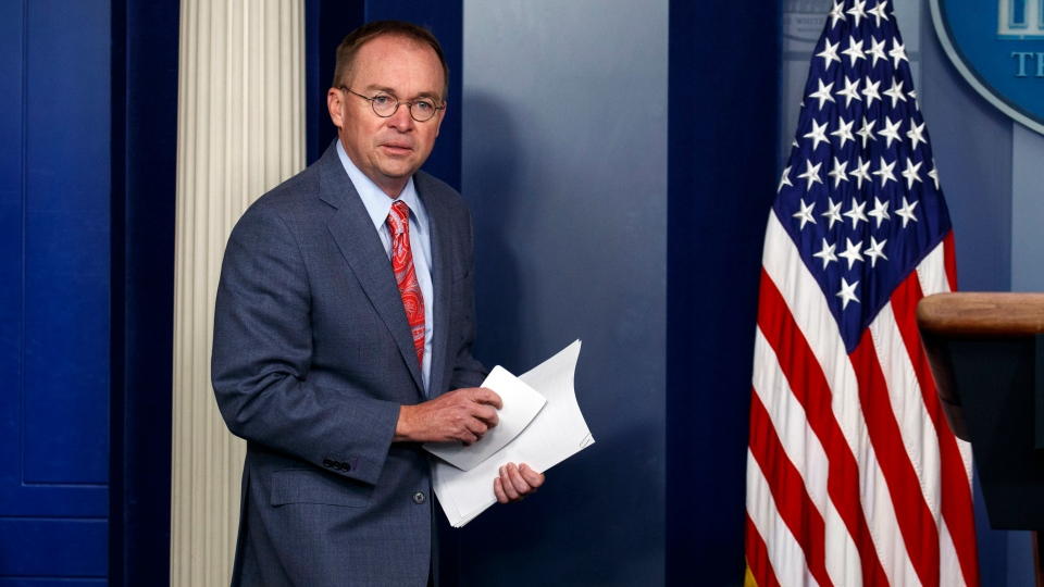 In this Thursday, Oct. 17, 2019, file photo, White House chief of staff Mick Mulvaney arrives to a news conference, in Washington. (AP Photo/Evan Vucci, File)