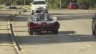 Landon Noden gets a ride in a Batmobile