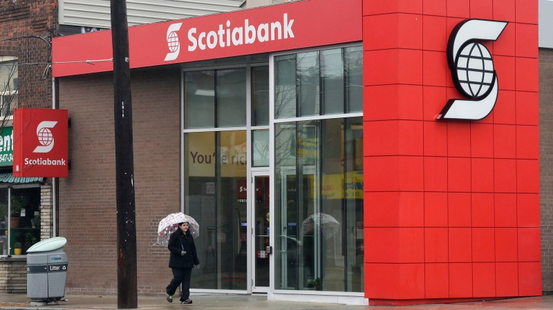 A woman walks by a Scotiabank branch in Toronto on Thursday, April 9, 2015. THE CANADIAN PRESS/Frank Gunn