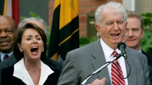 FILE - In this Jan. 5, 2007 file photo, Speaker of the House Nancy Pelosi, D-Calif., left, laughs as her brother Thomas D' Alesandro III, right, makes a joke as he introduces her husband Paul, during a street renaming ceremony in her behalf, in Baltimore. (AP Photo/Chris Gardner, File)