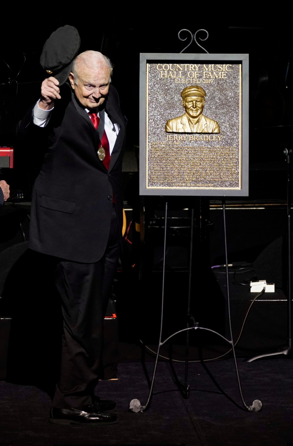 Jerry Bradley gives a tip of the hat after being inducted into the Country Music Hall of Fame during the 2019 Medallion Ceremony at the Country Music Hall of Fame and Museum on Sunday, Oct. 20, 2019 in Nashville, Tenn. (Photo by Sanford Myers/Invision/AP)