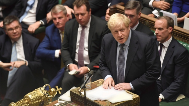 Britain's Prime Minister Boris Johnson speaks during the Brexit debate inside the House of Commons in London Saturday Oct. 19, 2019. (Jessica Taylor/House of Commons via AP)