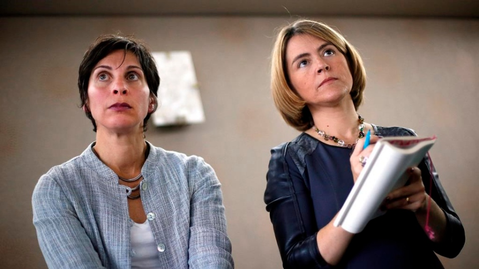 United Nations human rights experts Leilani Farha (left) and Catarina de Albuquerque listen to questions during a news conference in Detroit, Monday, Oct. 20, 2014.  THE CANADIAN PRESS/AP/Paul Sancya