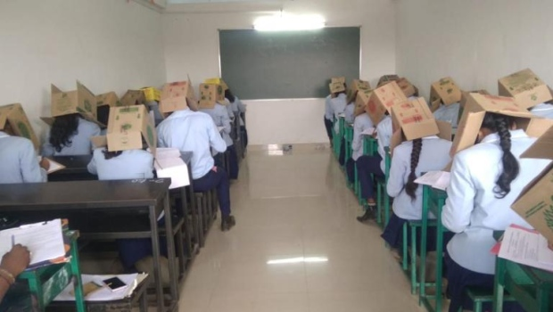 Students at an Indian school wore cardboard boxes on their heads as an anti-cheating measure on October 16, 2019. (Bhagat Pre-University College/CNN)