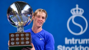 Denis Shapovalov of Canada, holds the trophy after winning the Stockholm Open tennis tournament men's single final at the Royal Tennis Hall in Stockholm, Sweden, Sunday Oct. 20, 2019. (Henrik Montgomery / TT via AP)