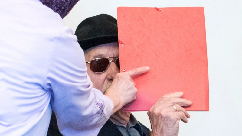 Ninety-three-year-old former SS guard Bruno Dey in the concentration camp Stutthof near Danzig, arrives at the regional court in Hamburg, Germany, Monday, Oct. 21, 2019. The prosecution accuses the 93-year-old man of aiding and abetting the murder of 5230 people. (Daniel Bockwoldt/dpa via AP)