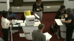 Displaced voters cast ballots downtown