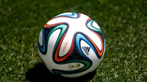 In this May 31, 2014, file photo an official 2014 FIFA World Cup soccer ball lies on the grass during an open practice by the United States in Harrison, N.J.  (AP Photo/Julio Cortez, File)