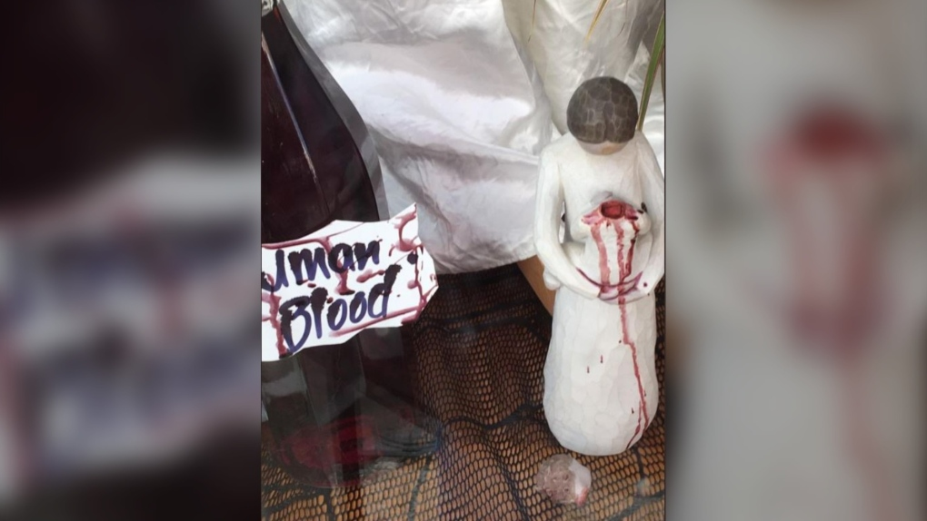 British thrift store slammed for Halloween window display depicting decapitated baby