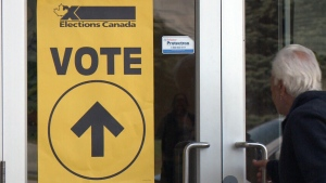 A voter enters a polling station in Ottawa