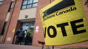 Voters enter the polling station at St. Luigi Catholic School during election day in Toronto on Monday, October 21, 2019. THE CANADIAN PRESS/ Tijana Martin
