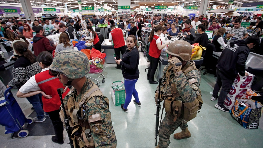 More violent clashes in Chile as many line up for food