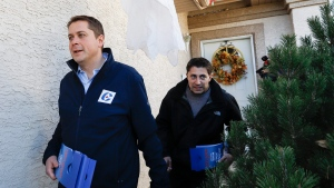 Conservative leader Andrew Scheer, left, and candidate Mike Kram campaign in Regina, Sask., Monday, Oct. 21, 2019.THE CANADIAN PRESS/Jeff McIntosh