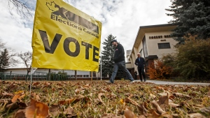Voters make their way to cast their vote in Edmonton Alta, on Monday, October 21, 2019. THE CANADIAN PRESS/Jason Franson