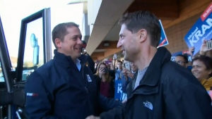 Andrew Scheer meets with Regina-Wascana candidate Michael Kram on Election Day in Regina.