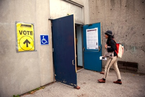 A voter arrives to cast their ballot at Howard Junior Public School in Toronto on Monday, Oct. 19, 2015. THE CANADIAN PRESS/Marta Iwanek