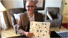 Khalid Nasir is seen here with a package that was meant to be delivered 18 years ago. (CTV News Toronto)
