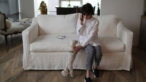 In this April 13, 2019, file photo, Laura Pontikes talks on the phone in her apartment in Houston. The Texas construction company executive and mother of three had been seeking God when she began spiritual counseling with Monsignor Frank Rossi. A Texas grand jury has declined to indict the onetime deputy to Cardinal Daniel DiNardo on charges he sexually assaulted Laura Pontikes, a married woman, in a case that raised questions about consent in the #MeToo era. The Harris County District Attorney's Office had presented the case against Monsignor Frank Rossi on Monday, more than a year after Pontikes filed a criminal complaint with Houston police. (AP Photo/Wong Maye-E, File)