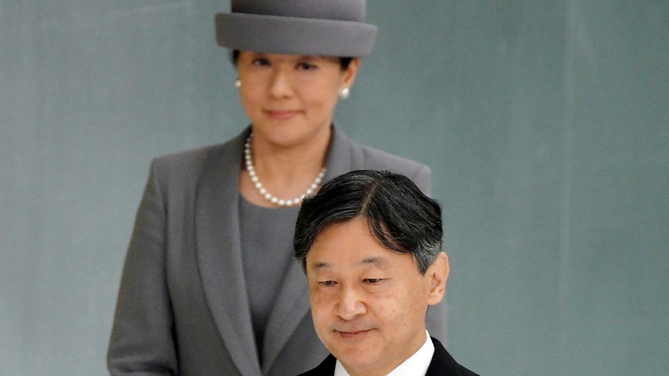 In this Aug. 15, 2019, file photo, Japanese Emperor Naruhito, accompanied by Empress Masako, walks to deliver his remarks during a memorial ceremony for the war dead at Nippon Budokan Martial Arts Hall in Tokyo. (AP Photo/Eugene Hoshiko, File)