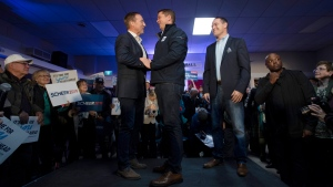Local conservative candidate George Canyon, right, looks on as Conservative leader Andrew Scheer, centre, shakes hands with Peter MacKay during a campaign stop in Little Harbour, N.S. Thursday October 17, 2019. THE CANADIAN PRESS/Adrian Wyld
