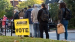 People line up to enter a polling station on election day of the 2019 federal election, in Ottawa, Monday, Oct. 21, 2019. THE CANADIAN PRESS/Justin Tang