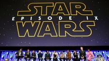 """In this April 12, 2019, file photo, Stephen Colbert, from left, J.J. Abrams, Kathleen Kennedy, Anthony Daniels, Billy Dee Williams, Daisy Ridley, John Boyega, Oscar Isaac, Kelly Marie Tran, Joonas Suotamo and Naomi Ackie participate in the """"Star Wars: The Rise of Skywalker"""" panel on day 1 of the Star Wars Celebration at Wintrust Arena in Chicago. Disney on Monday, Oct. 21, debuted the final trailer for """"Star Wars: The Rise of Skywalker,"""" the ninth installment in the """"Star Wars"""" film franchise that tells the story of the powerful Skywalker family. (Photo by Rob Grabowski/Invision/AP, File)"""