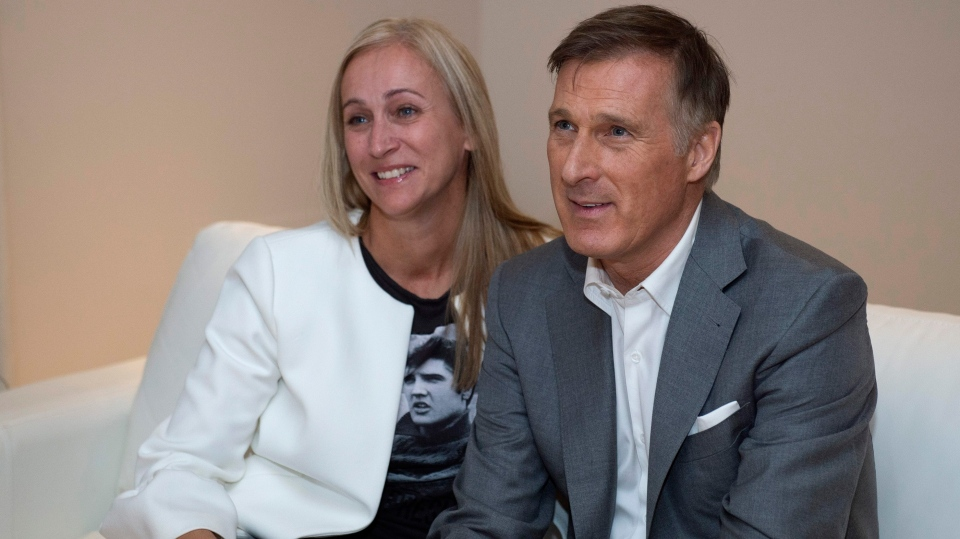 People's Party of Canada Leader Maxime Bernier and his wife Catherine Letarte watch election results on television, Monday, October 21, 2019 in Beauceville, Que. Canadians are going to the polls in a general election. THE CANADIAN PRESS/Jacques Boissinot