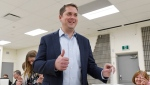 Conservative Leader Andrew Scheer gives a thumbs up as he votes in the federal election in Regina on Monday, Oct. 21, 2019. THE CANADIAN PRESS/Adrian Wyld