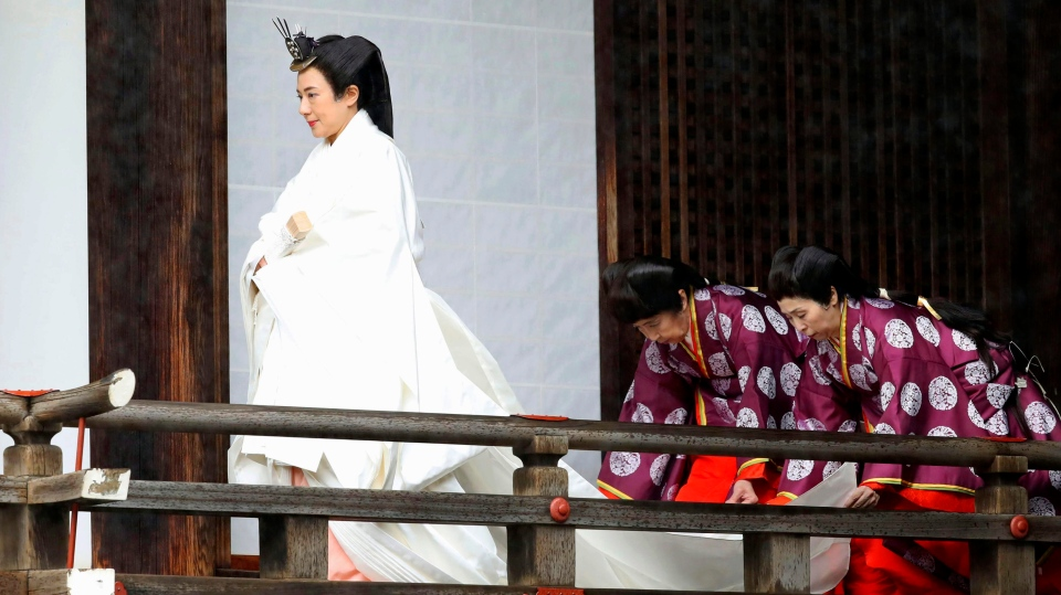 "Japan's Empress Masako visits ""Kashikodokoro"", one of three shrines at the Imperial Palace, in Tokyo, Tuesday, Oct. 22, 2019. Emperor Naruhito and Empress Masako visited three Shinto shrines at the Imperial Palace before Naruhito proclaims himself Japan's 126th emperor in an enthronement ceremony. (Kyodo News via AP)"