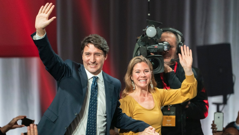 Liberal Leader Justin Trudeau and wife Sophie Gregoire Trudeau wave as they go on stage at Liberal election headquarters in Montreal, Monday, Oct. 21, 2019. (THE CANADIAN PRESS/Paul Chiasson)