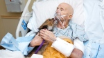 John Vincent, a marine who fought in Vietnam, got to his dog one last time after being transferred to a nearby hospice facility. (Albuquerque Animal Welfare)