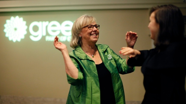 Green Party leader Elizabeth May greets her daughter Cate May Burton as she arrives during election night at Crystal Gardens in Victoria, B.C., on Monday, October 21, 2019. THE CANADIAN PRESS/Chad Hipolito