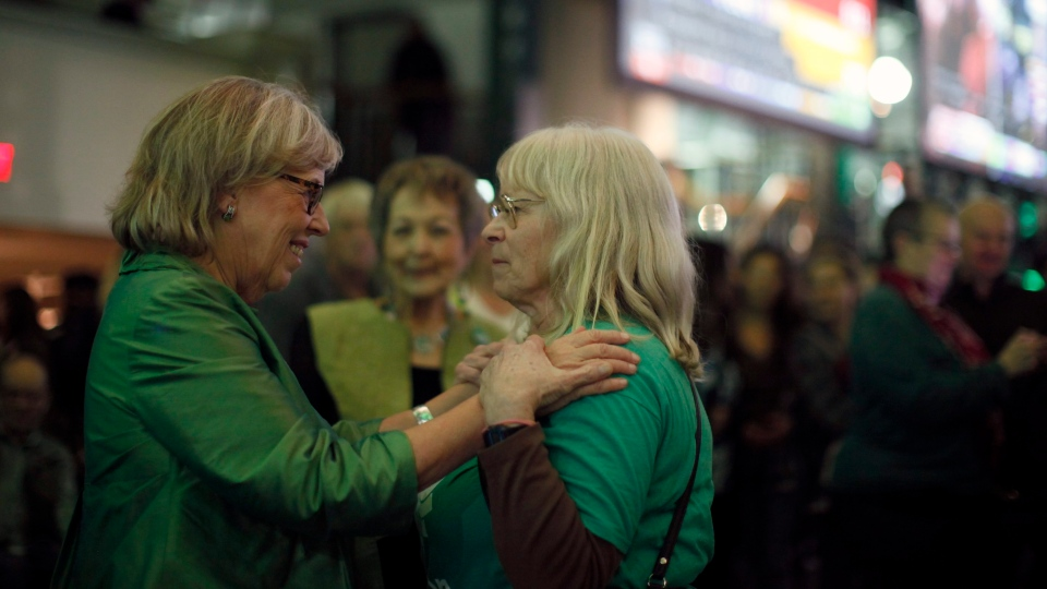 Green Party leader Elizabeth May shares a moment with Diane Bell, a friend from her parish church, as results come in during election night at Crystal Gardens in Victoria, B.C., on Monday, October 21, 2019. (THE CANADIAN PRESS / Chad Hipolito)