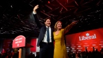 Liberal leader Justin Trudeau and wife Sophie Gregoire-Trudeau celebrate at Liberal election headquarters in Montreal on Tuesday Oct. 22, 2019. THE CANADIAN PRESS/Sean Kilpatrick