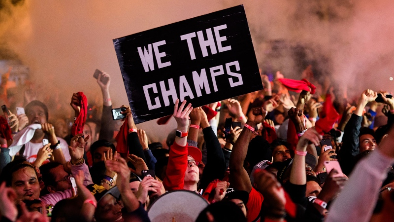 Toronto Raptors fans react inside Jurassic Park, outside of the Scotiabank Arena, in Toronto, as they watch the Raptors defeat the Golden State Warriors in game 6 of the NBA Finals to win the NBA Championship, Thursday, June 13, 2019. THE CANADIAN PRESS/Nathan Denette