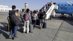 Passengers board an Egyptair Express plane bound for Cairo at Sharm el-Sheikh Airport, south Sinai, Egypt, on Nov. 9, 2015. (Thomas Hartwell / AP)