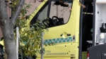 A damaged ambulance with bullet holes in the door is seen crashed into a building after an incident in the center of Oslo, on Oct. 22, 2019.  (Stian Lysberg Solum / NTB scanpix via AP)