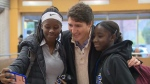 Newly re-elected Prime Minister Justin Trudeau takes selfies with commuters in the Montreal Metro.