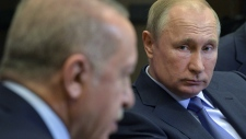 Putin, right, listens to Erdogan in Sochi