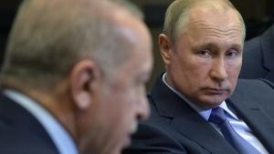 Putin, right, listens to Erdogan in Sochi