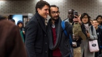 Prime Minister Justin Trudeau greets commuters at a metro station in Montreal, Tuesday, Oct. 22, 2019. THE CANADIAN PRESS/Sean Kilpatrick