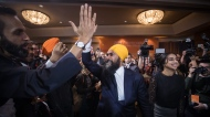 NDP Leader Jagmeet Singh and his wife Gurkiran Kaur Sidhu greet supporters during an election night party in Burnaby, B.C., on Monday October 21, 2019. THE CANADIAN PRESS/Darryl Dyck