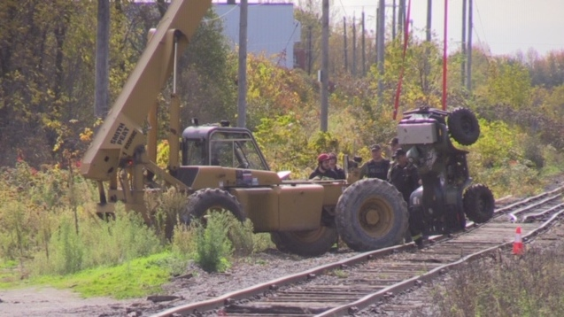 An ATV that was found on a body is lifted out of a wooded area just off Thames Road in the north end of Exeter, Ont. on Tuesday, Oct. 22, 2019. (Scott Miller / CTV London)